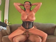 Huge titted milf fucks a hrad young stud